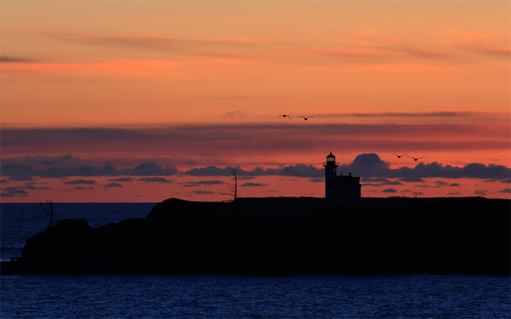 arago lighthouse sunset photo dark