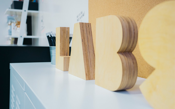 invision labs office logo wooden blocks